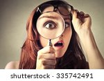 shocked woman looking through a ... | Shutterstock . vector #335742491