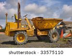 small beat up old yellow dumper ...