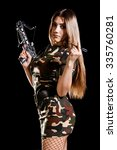 Small photo of Military woman loading the arbalest over black background