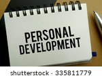 Personal development memo written on a notebook with pen - stock photo