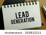 Lead generation memo written on a notebook with pen - stock photo