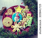Small photo of Christmas cookies decorated with fondant on table