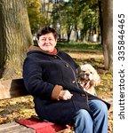 Senior Woman Sitting On A Benc...