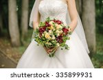 the bride with a bouquet | Shutterstock . vector #335899931
