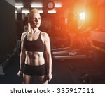 sport  fitness woman in gym.... | Shutterstock . vector #335917511