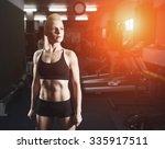 sport  fitness woman in gym.... | Shutterstock . vector #335917511
