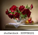 Small photo of bouquet from red peonies in ceramic vase with plate of apples and pear on table on beige background