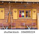 old wooden chalet with... | Shutterstock . vector #336000224