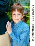 the boy in the blue shirt. | Shutterstock . vector #336102971