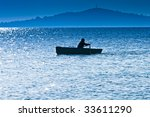Silhouette of the fisherman - stock photo