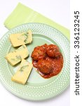 Small photo of Delicious meat balls in tomato sauce with cornmeal mush and brocoli