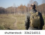 man with a backpack on his... | Shutterstock . vector #336216011