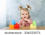 Baby Girl Playing With A Toys