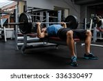 Man during bench press exercise ...