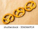 pretzels on brown paper...   Shutterstock . vector #336366914