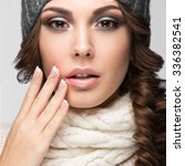 Small photo of Beautiful girl with gentle makeup, design manicure and gray hat. Warm winter image. Beauty face.