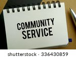 Community service memo written on a notebook with pen - stock photo