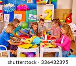 group kids learning and holding ... | Shutterstock . vector #336432395