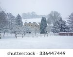A Snowy Winter Scene Of A Smal...