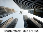 tall city buildings and a plane ... | Shutterstock . vector #336471755
