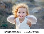 beautiful little angel girl  | Shutterstock . vector #336505901