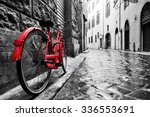 Stock photo retro vintage red bike on cobblestone street in the old town color in black and white old 336553691