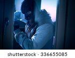 burglar with crowbar to break...
