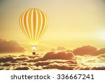 Balloon Above The Clouds At...