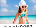 adorable little girl at beach... | Shutterstock . vector #336681827