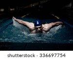 sportsman swims in a swimming... | Shutterstock . vector #336697754