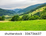 Village In Mountains Behind Th...