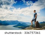 male hiker on the top of a... | Shutterstock . vector #336757361