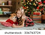 Happy Little Girl And Dog At...