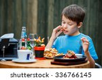 Cute Healthy Teenager Boy Eats...