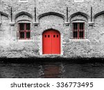 Red Door And Two Windows At...