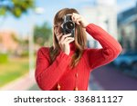 woman photographing | Shutterstock . vector #336811127