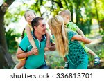 happy family in the park.... | Shutterstock . vector #336813701