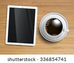 a cup of coffee with a tablet ... | Shutterstock .eps vector #336854741