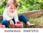 toddler girl putting on her... | Shutterstock . vector #336872921