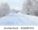 Snowy Road Through The Forest ...