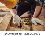 young man builder in workwear... | Shutterstock . vector #336902471