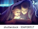 two kids using tablet pc under... | Shutterstock . vector #336928517