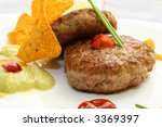 two burger on plate with avocado cream decoration tomato and mustard and nachos chips - stock photo