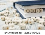 taxes word written on wood block | Shutterstock . vector #336940421