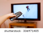 kid holding tv remote... | Shutterstock . vector #336971405