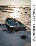 Boat Frozen In Fjord In Winter...