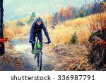 mountain biker riding in autumn ... | Shutterstock . vector #336987791