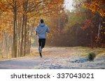 Young Man Running At Park...