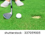 golfer with club rolls up a... | Shutterstock . vector #337059005