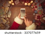 Santa Claus Using A Touch...